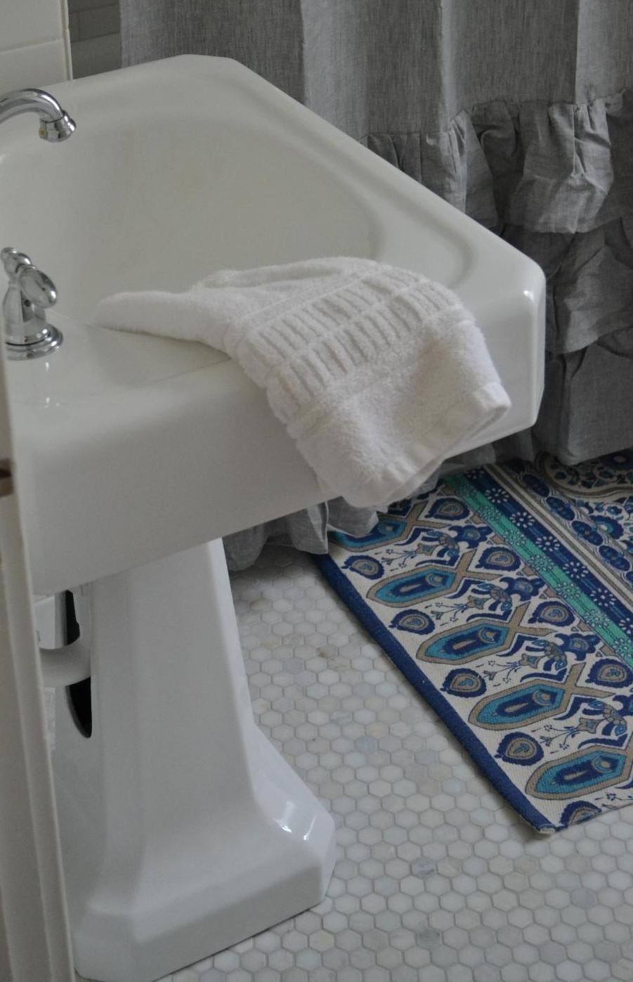 Cottage Fix - vintage sink and marble hex floor tile