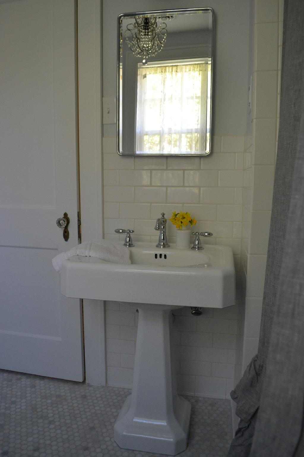 Cottage Fix - refinished vintage sink, Delta faucet, marble hes tiles, and sparkly chandy