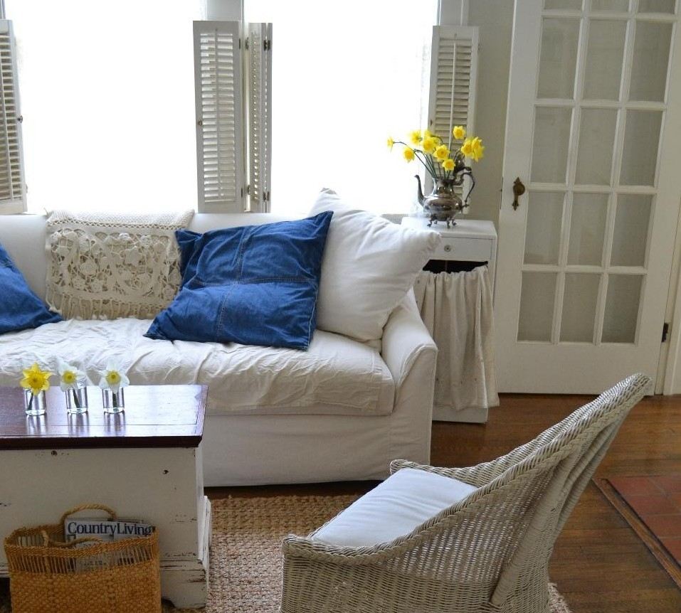 Cottage Fix - blue denim pillows, white sofa, and daffodils