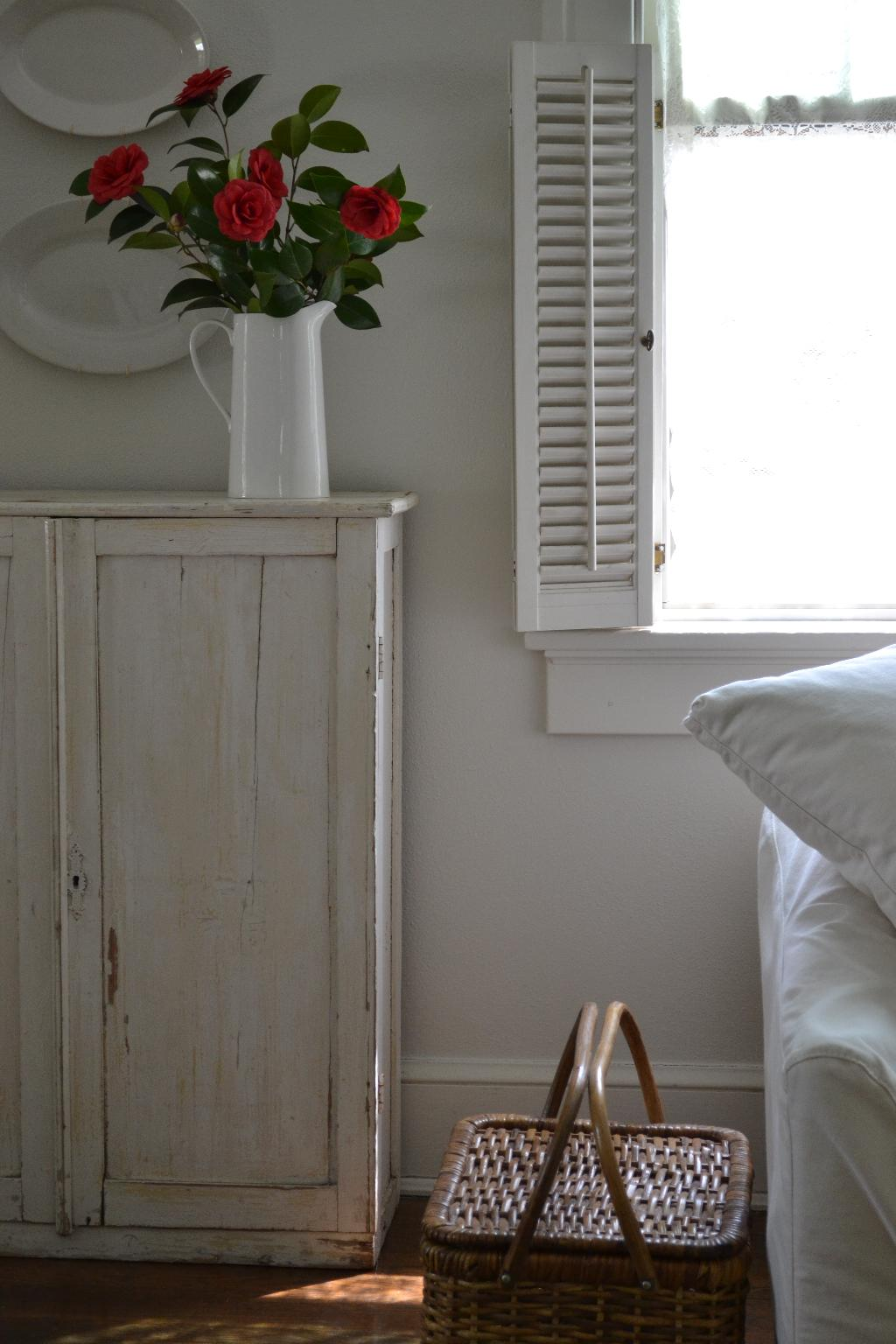 Cottage Fix blog - warm whites, red camellias, and a picnic basket