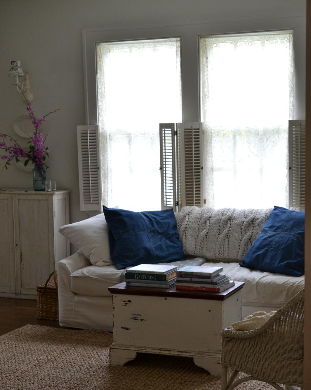 Cottage Fix blog - living room with cable knit throw, denim shams, and a chippy trunk