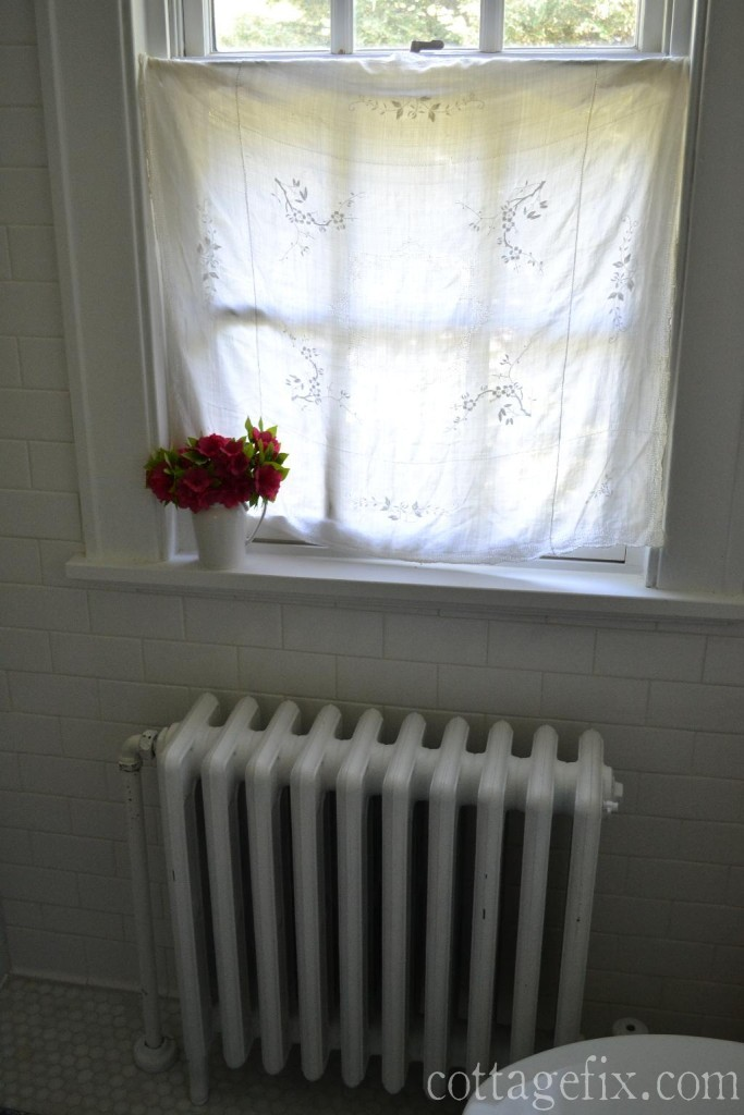 Cottage Fix blog - bathroom window treatment made with a vintage linen tablecloth and a spring rod