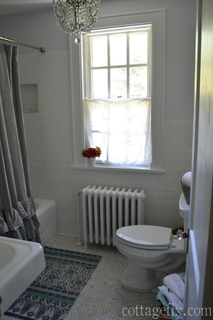 Cottage Fix blog - cottage style bathroom remodel with marble hex floor tiles, classic subway wall tiles, a crystal chandelier , and vintage accessories