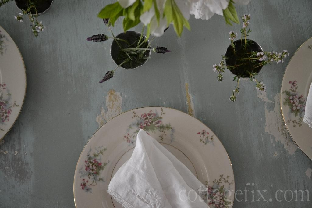 Cottage Fix blog - herb blooms in vintage molds at each place setting
