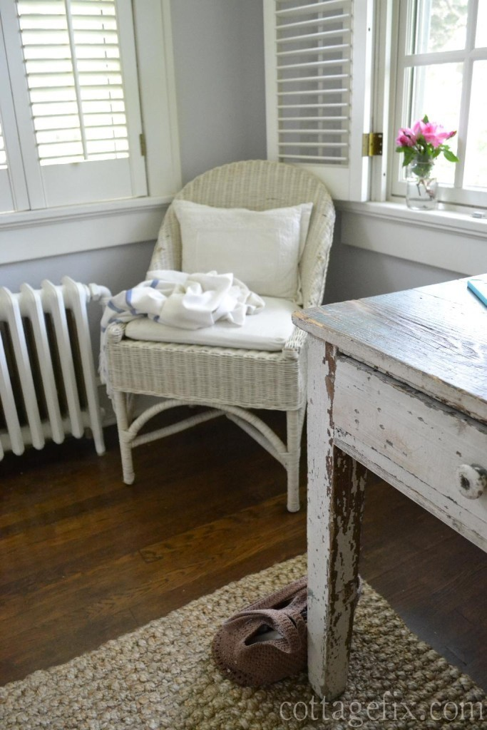 Cottage Fix blog - silvery gray walls, white wicker, and a farm table desk