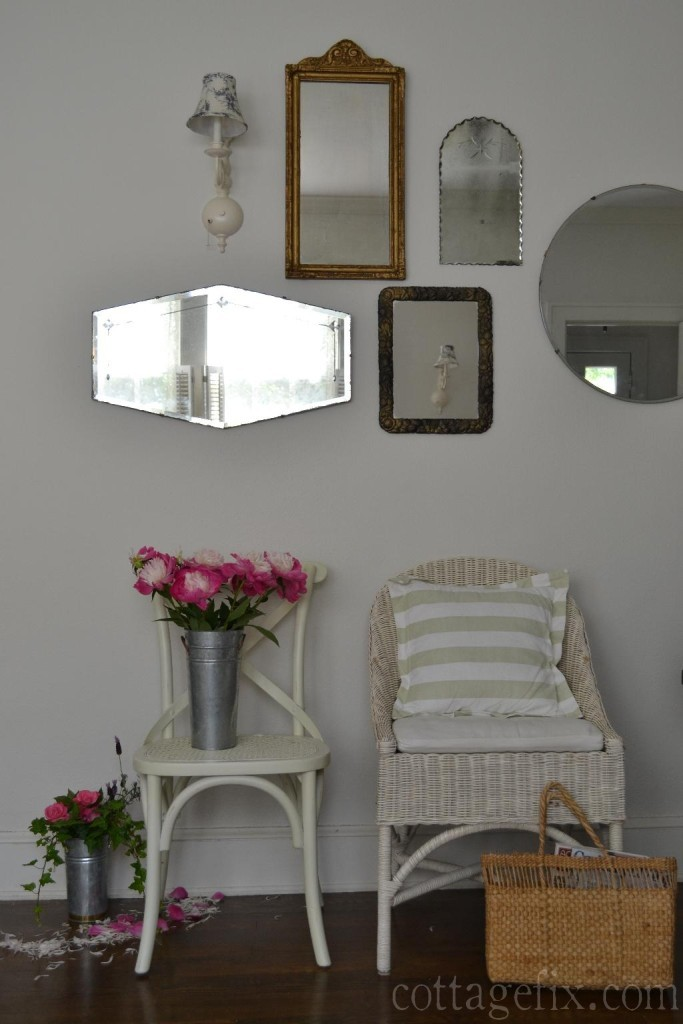 Cottage Fix blog - white chairs, vintage mirror collection, and bright pink peonies
