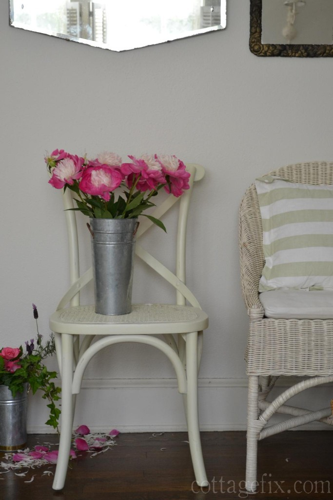 Cottage Fix blog - white chairs, vintage mirrors, and bright pink peonies