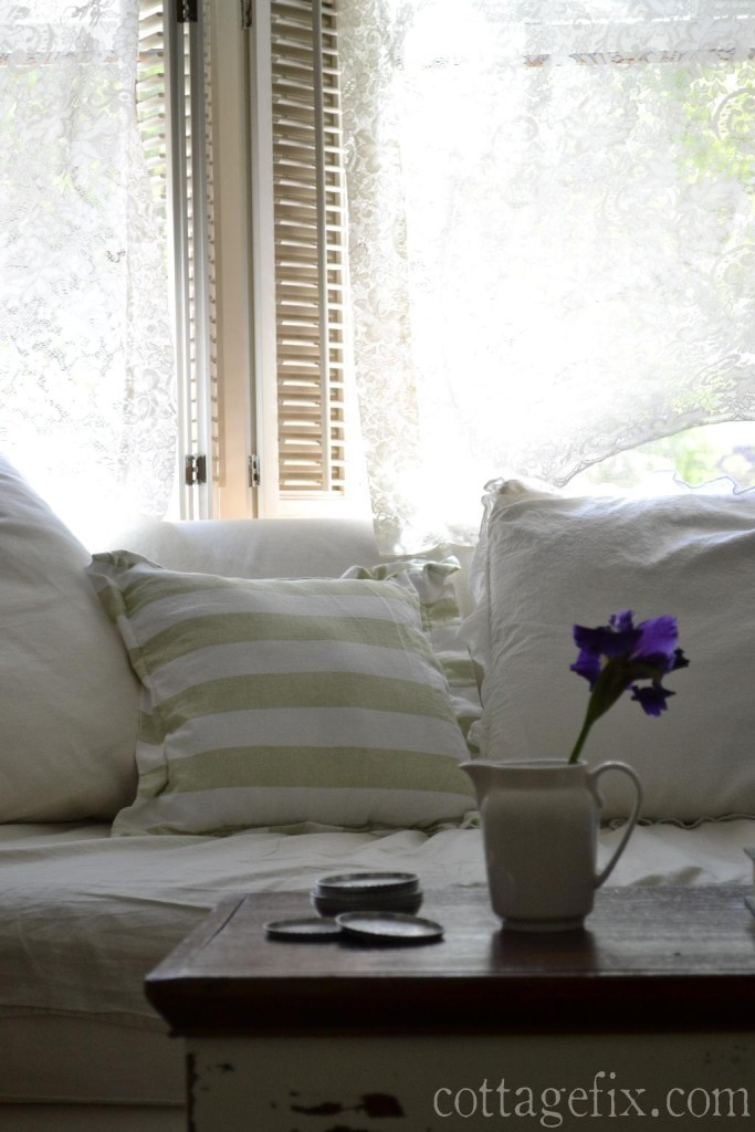 Cottage Fix blog - lacey curtains, green striped pillow, and a purple iris