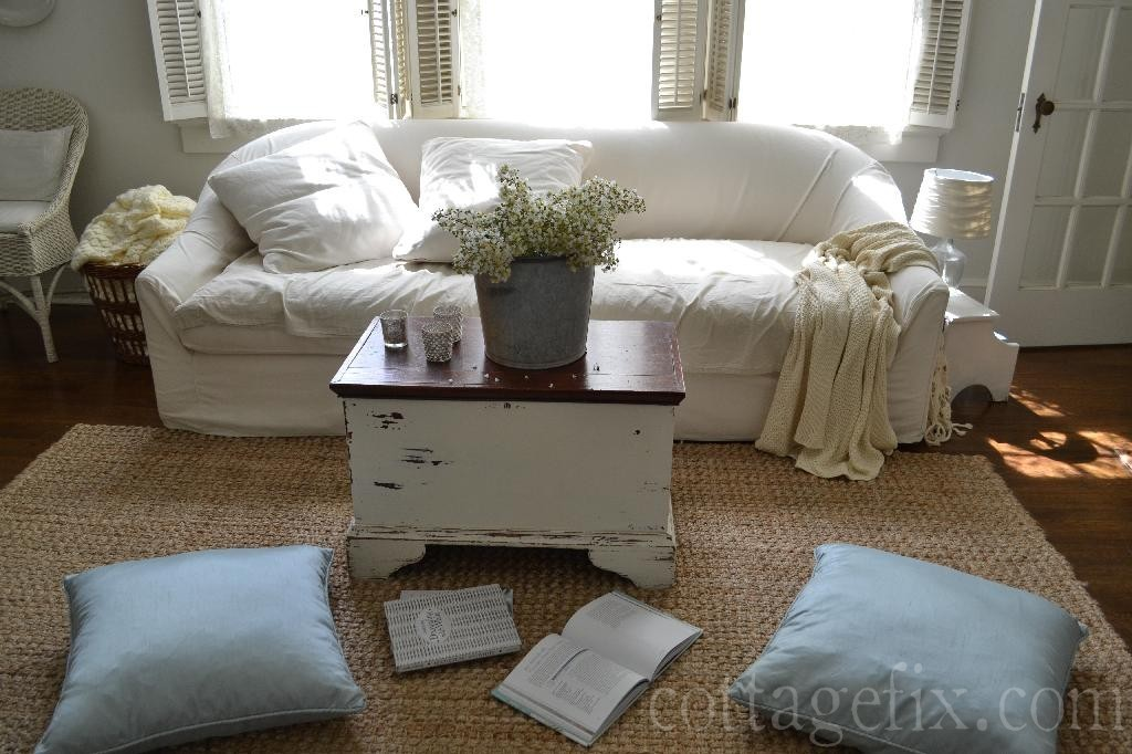 Cottage Fix blog - white living room with comfy white sofa and soft blue floor pillows
