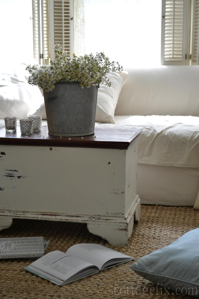 Cottage Fix blog - galvanized bucket with white blooms and white sofa