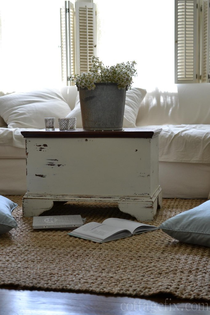 Cottage Fix blog - white sofa and a galvanized bucket with white blooms