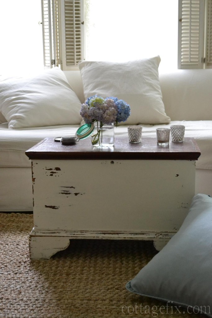 Cottage Fix blog - white sofa and a canning jar filled with hydrangea