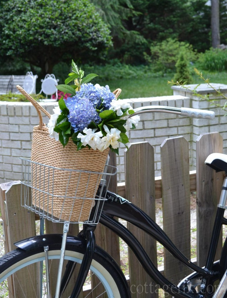Cottage Fix blog - beach basket with flowers and a bike