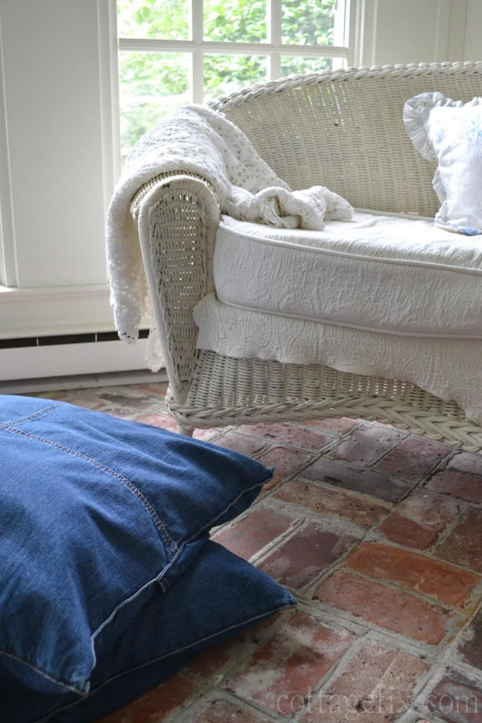 Cottage Fix blog - white wicker settee and denim floor pillows