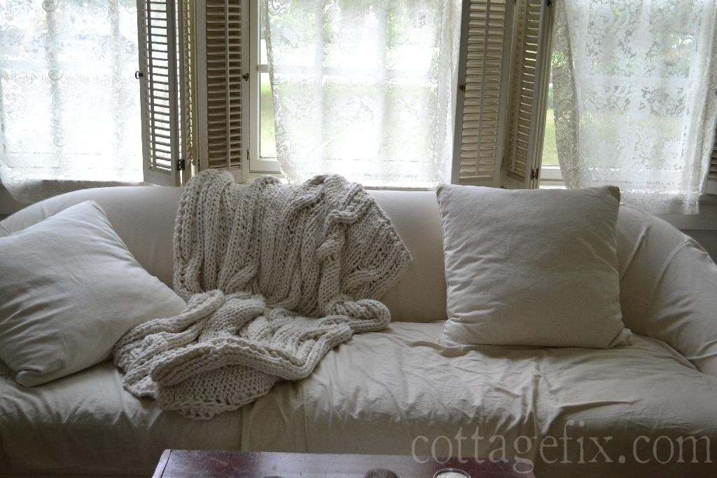 Cottage Fix blog - white slipcovered sofa and vintage lace window panels