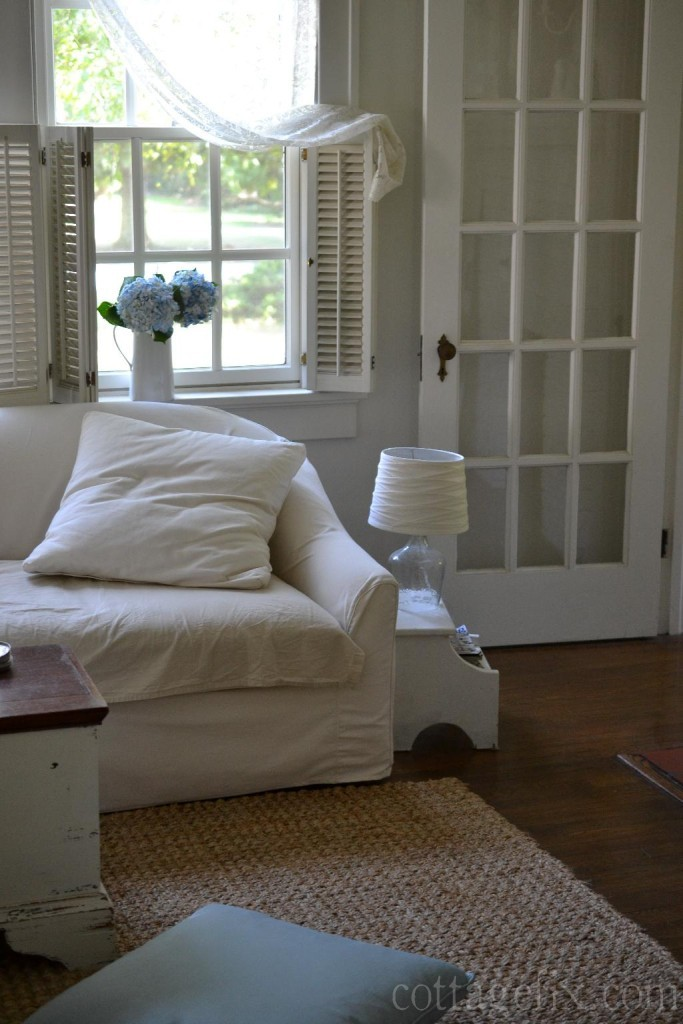 Cottage Fix blog - white sofa, natural fiber rug, and lace curtiains