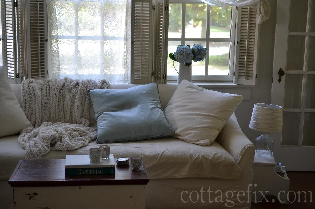 Cottage Fix blog - fresh blue hydrangeas in the cottage living room window