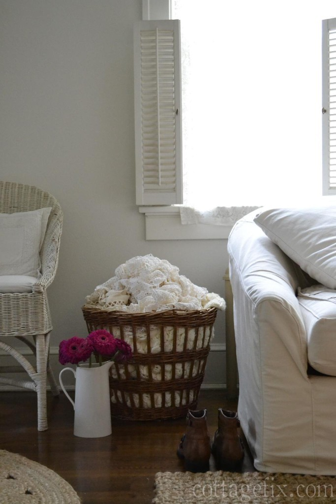 Cottage Fix blog - rich fuchsia blooms, french basket, and white slip sofa