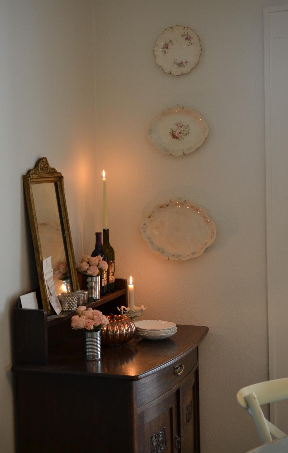 Cottage Fix blog - hanging vintage platters and candlelight