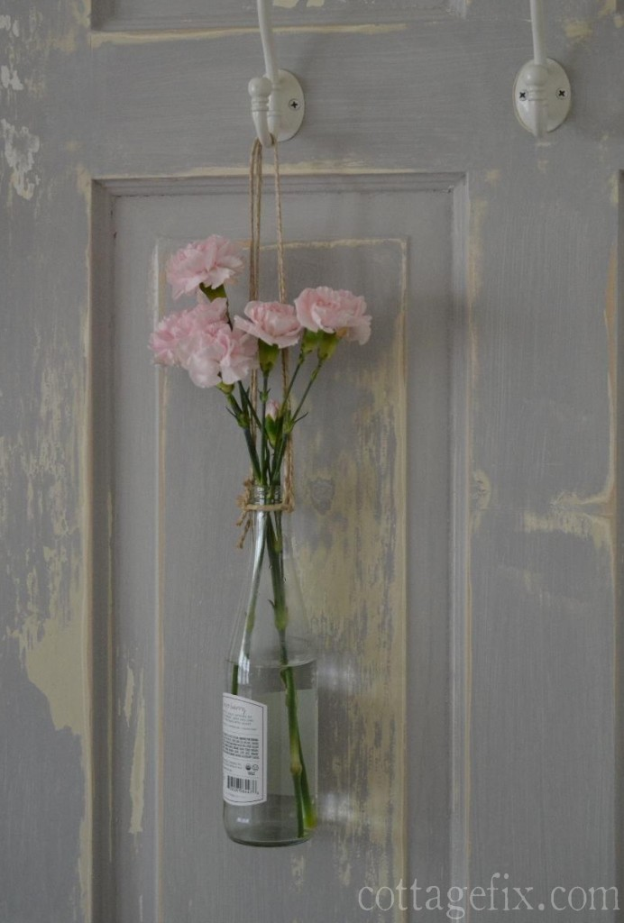Cottage Fix blog - pink blooms in a hanging bottle