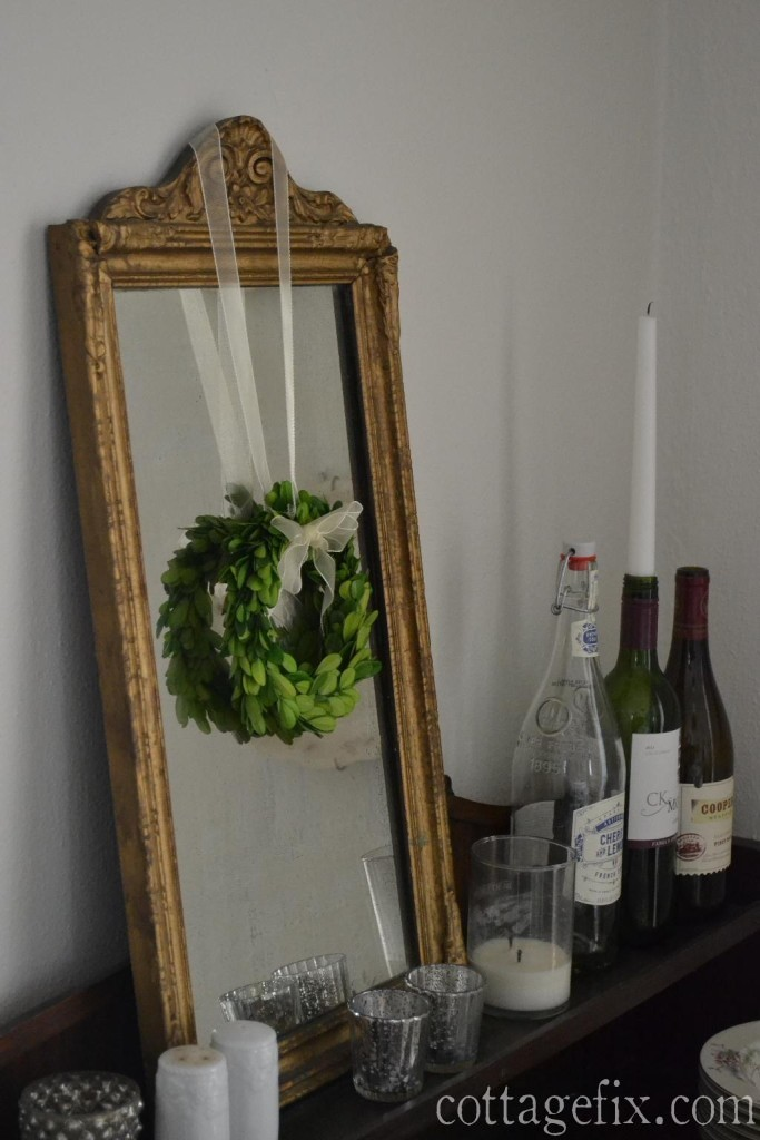 Cottage Fix blog - preserved boxwood wreath hanging on a French gold mirror