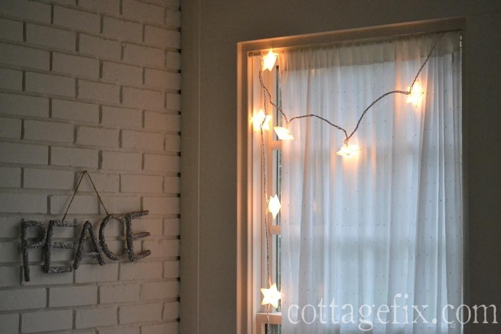 Cottage Fix blog - peace sparkle sign and bright stary lights for New Years