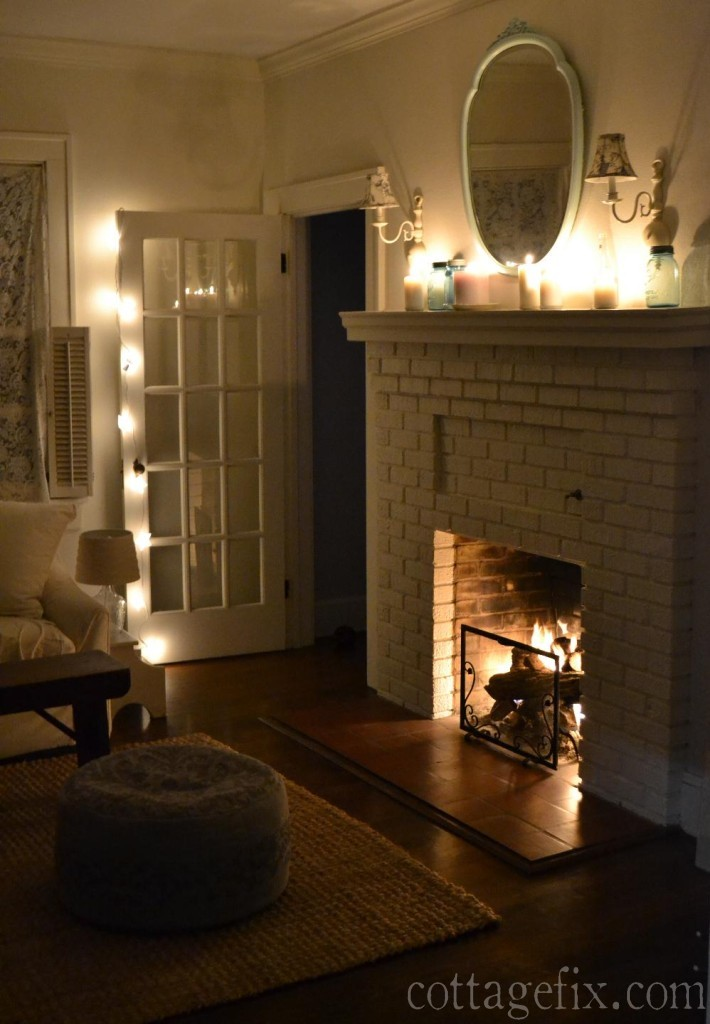 Cottage Fix blog - white candles, lights, and a cozy fire