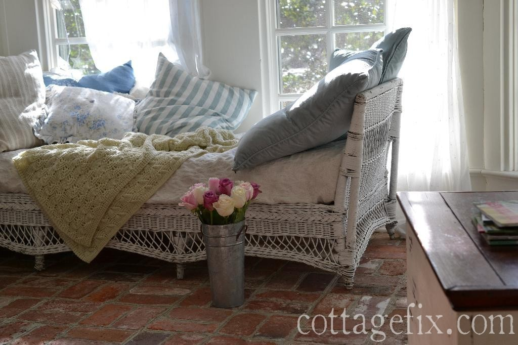 Cottage Fix blog - sun porch with white wicker and roses