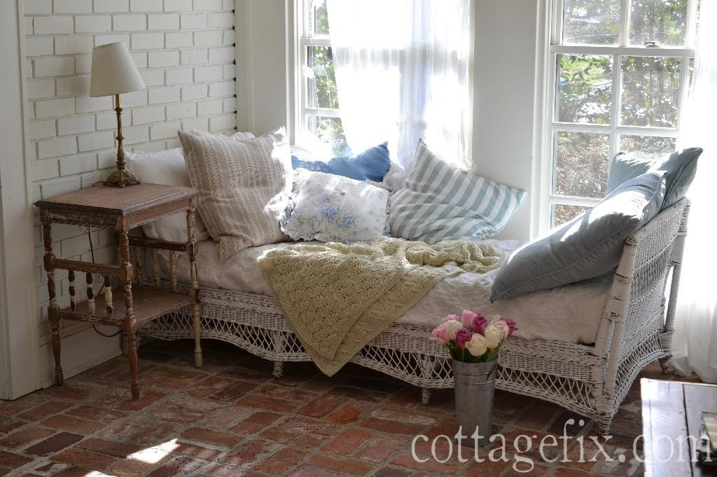 Cottage Fix blog - sun porch with white wicker and shabby chic pillows