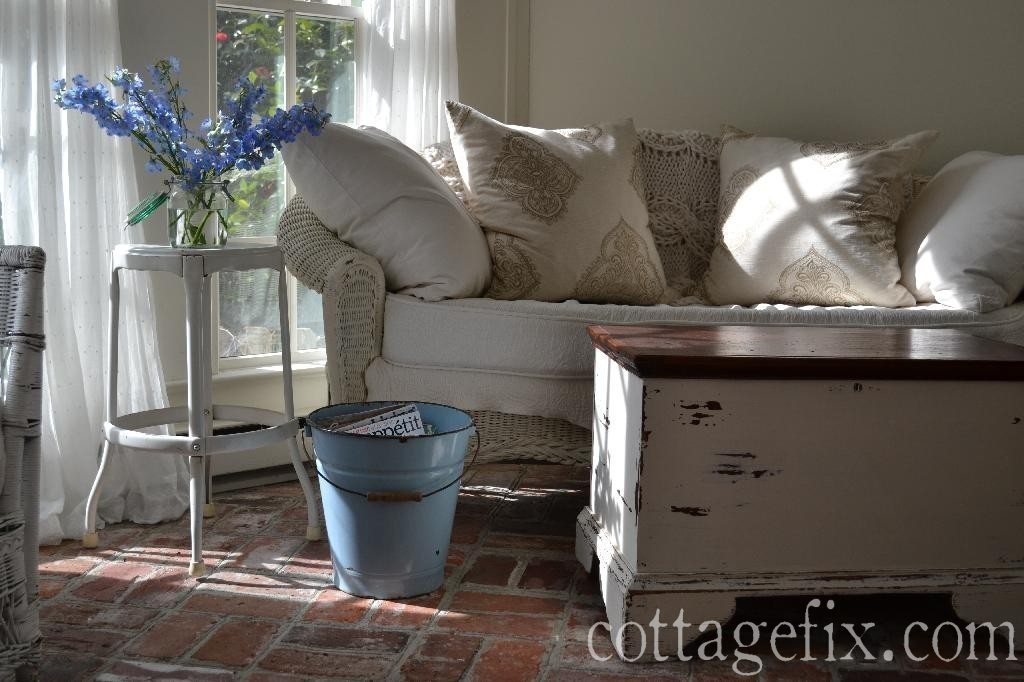 Cottage Fix blog - blue delphinium, wicker, and squishy pillows