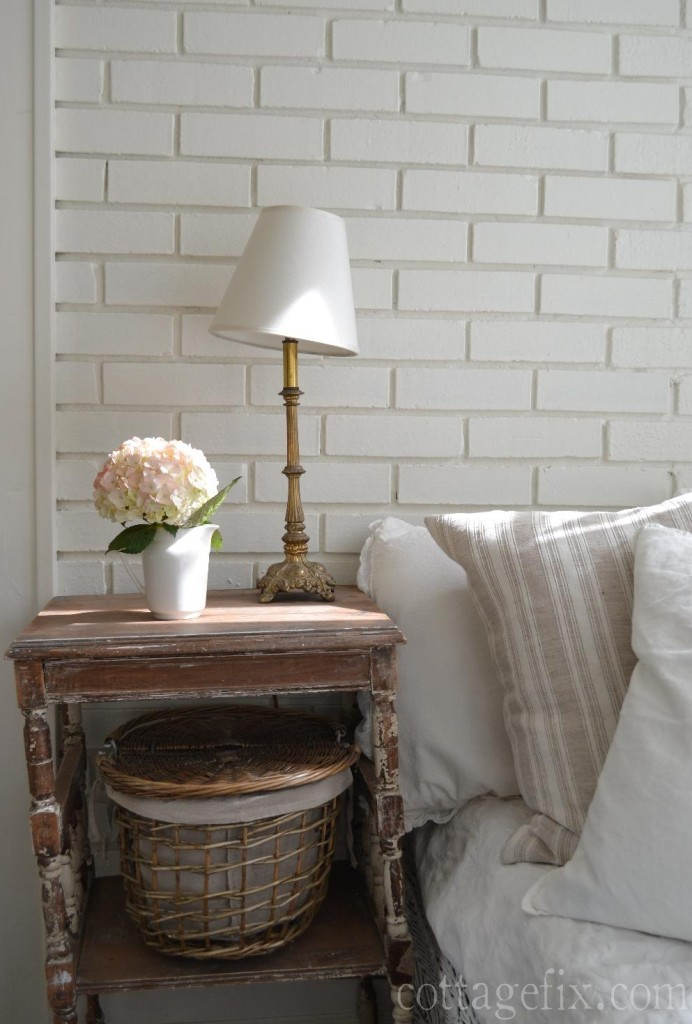 Cottage Fix blog - pale pink hydrangea bloom and vintage lamp