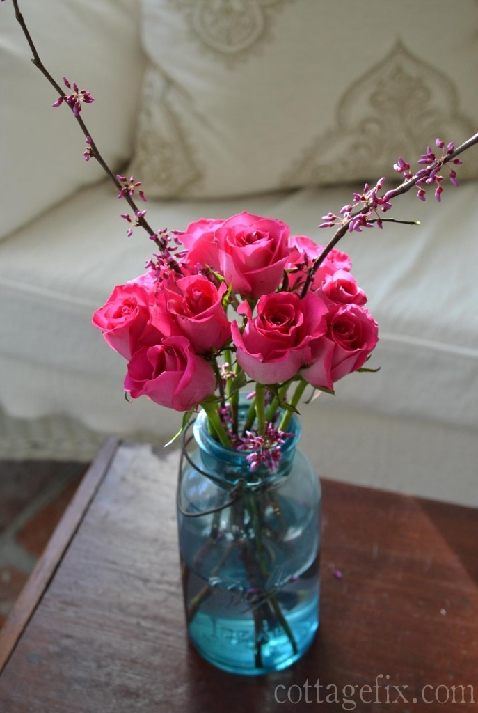 Cottage Fix blog - pink roses and red bud branches in a blue Ball jar