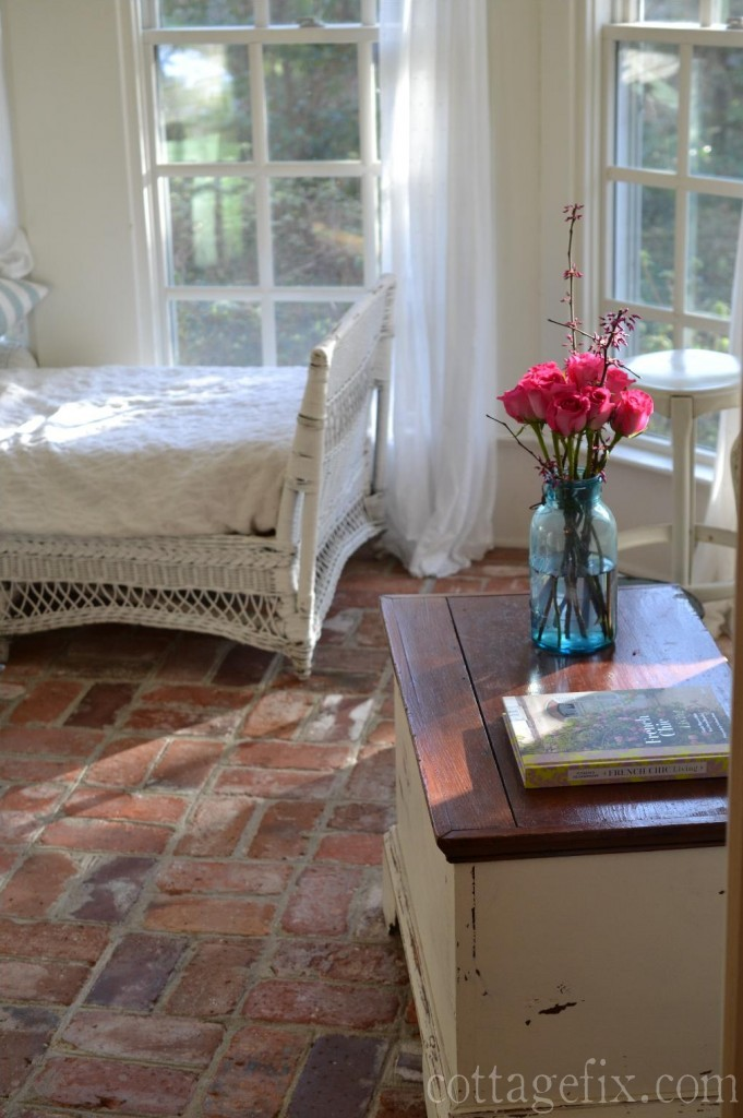 Cottage Fix blog - white wicker, brick floors, and pink roses