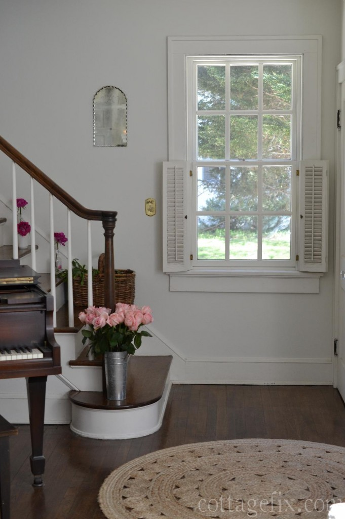 Cottage Fix blog - a sweet little vintage mirror in the cottage stairwell