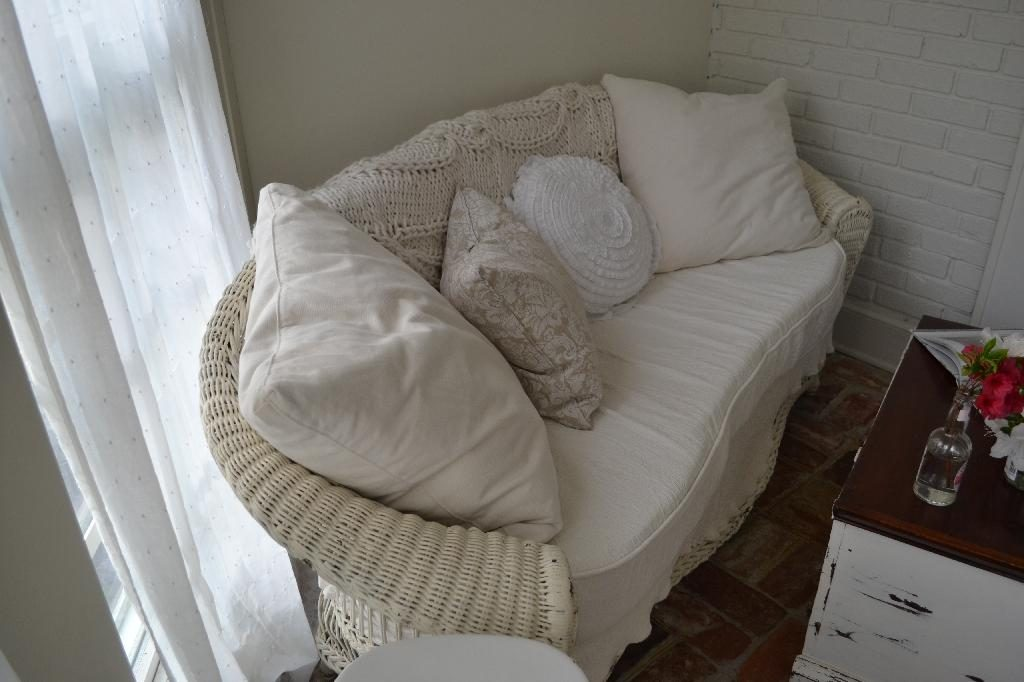 Cottage Fix blog - wicker settee with warm whites and shabby chic pillows