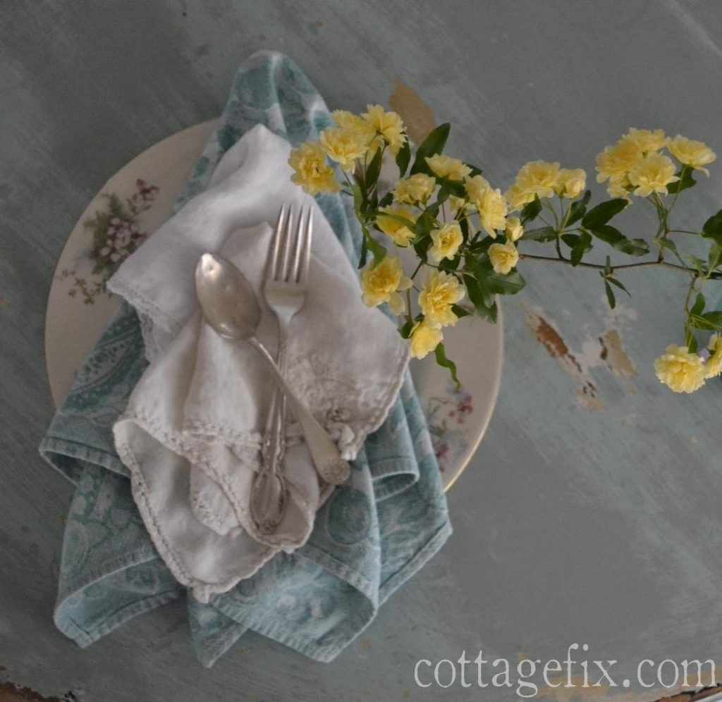 Cottage Fix blog - yellow, blue, and a hint of pink table setting