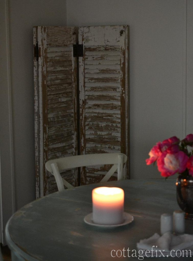 Cottage Fix blog - candle, peonies, and weathered shutters