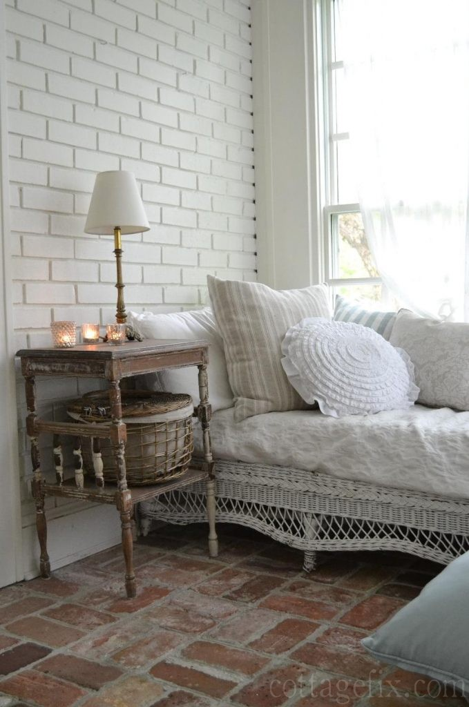 Cottage Fix blog - candlelight, ruffled pillow, and brick floors