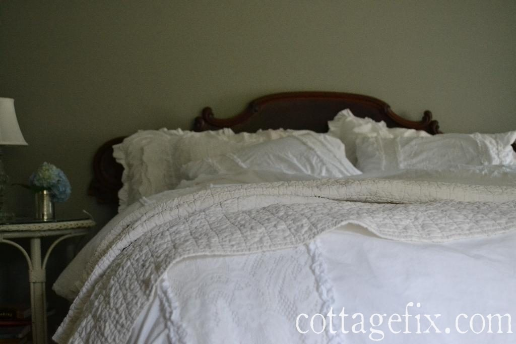 Cottage Fix blog - architectural salvage headboard and fluffy white bedding