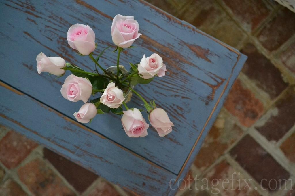 Cottage Fix blog - pink roses on blue shabby trunk