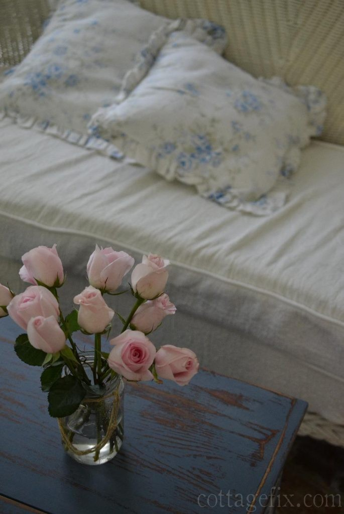 Cottage Fix blog - pink roses, blue trunk, and shabby chic pillows