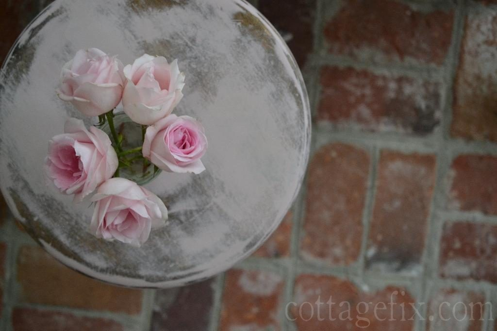 Cottage Fix blog - pale pink stool, roses, and brick floors