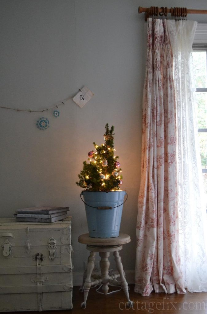 Cottage Fix blog - tiny tree with vintage baubles in a blue enamel bucket