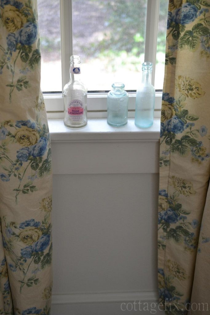 Cottage Fix blog - blue floral drapes and bottles