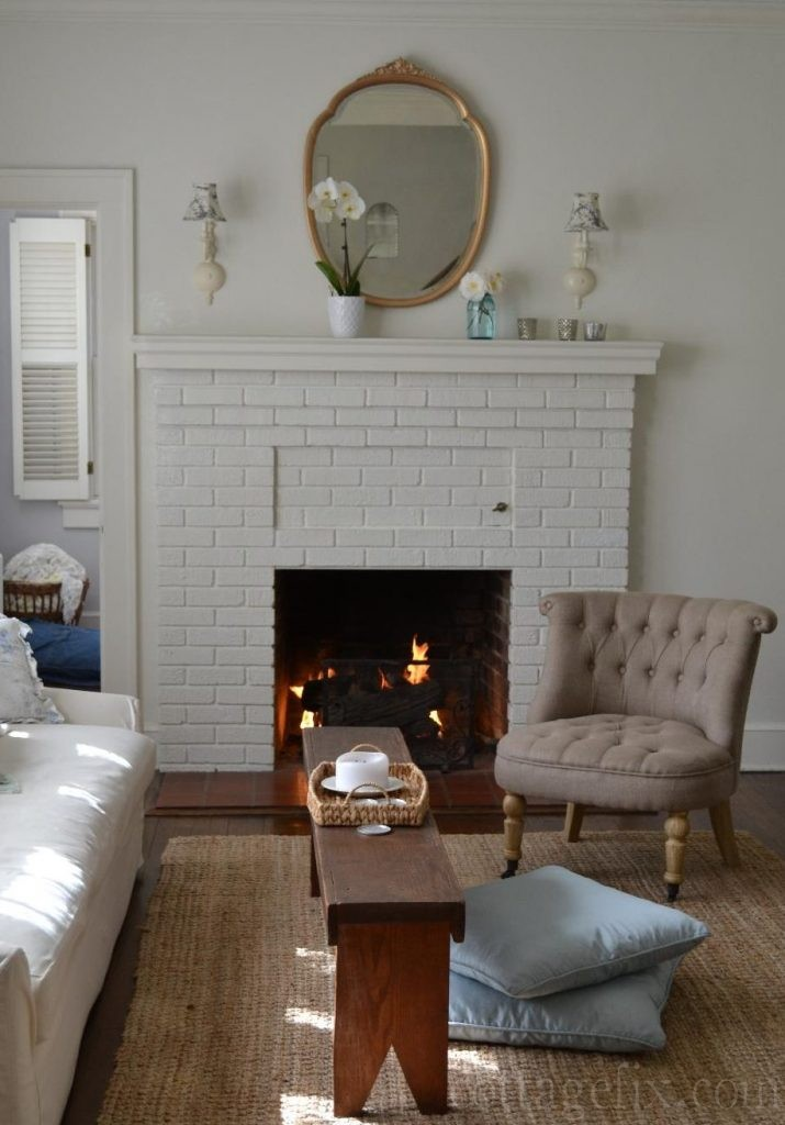 Cottage Fix blog - gold mirror, white painted brick, and French-y chair