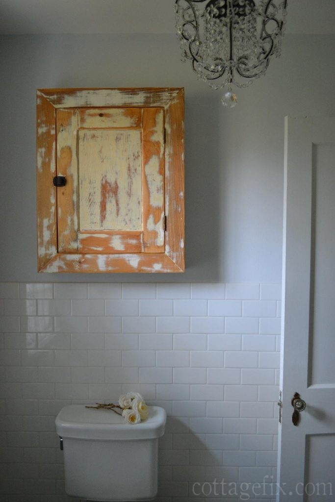 Cottage Fix blog - vintage bathroom cabinet, subway tiles, and crystal chandeler