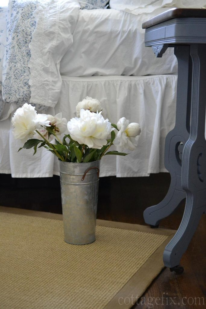 Cottage Fix blog - blue and white bedding, Old Violet painted side table, and white peonies