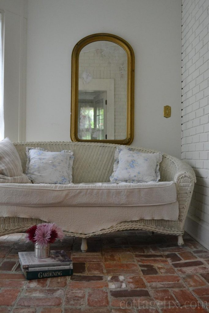 Cottage Fix blog - large gold mirror and floral pillows