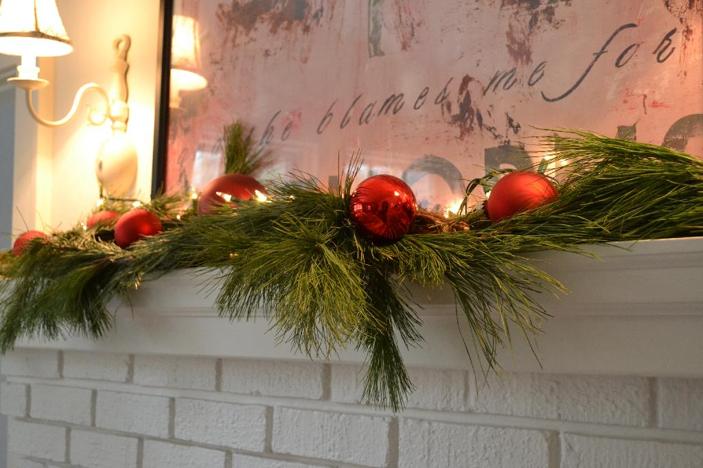 Cottage Fix blog - greenery and red baubles on our mantel