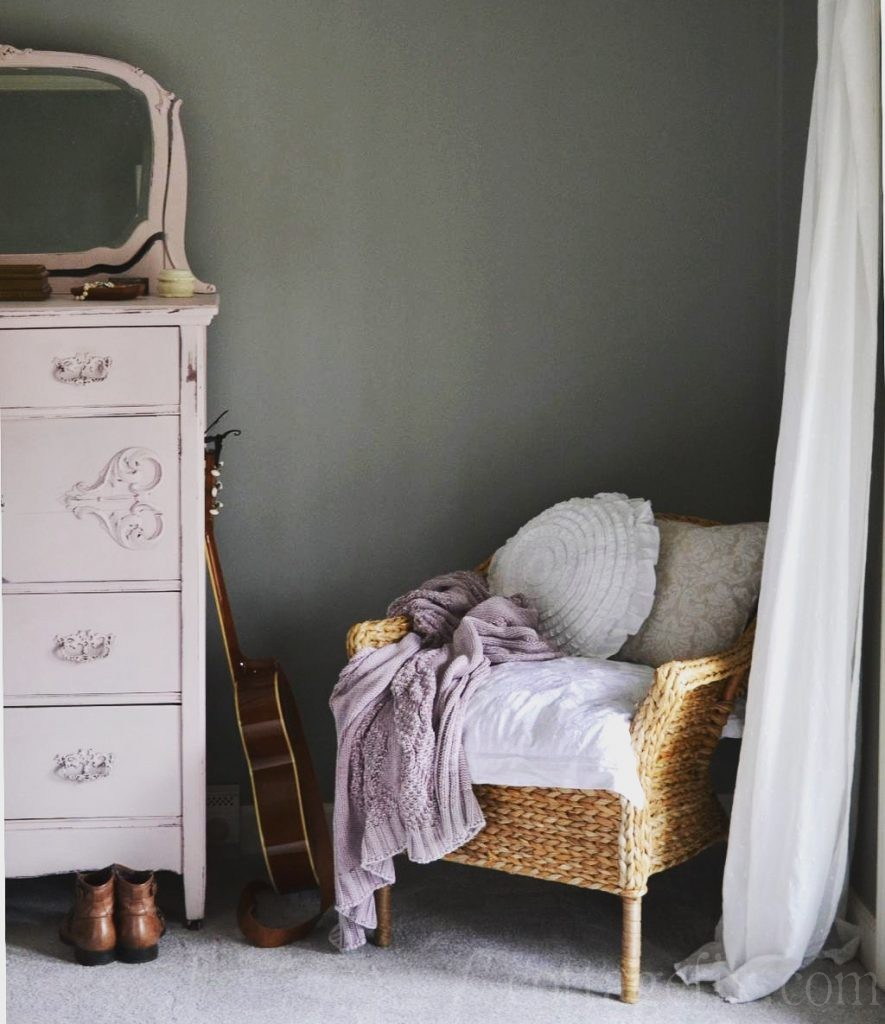 Cottage Fix blog - rattan chair piled high with shabby chic goodies